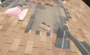 roofing shingles fixed as part of the process to repair a roof